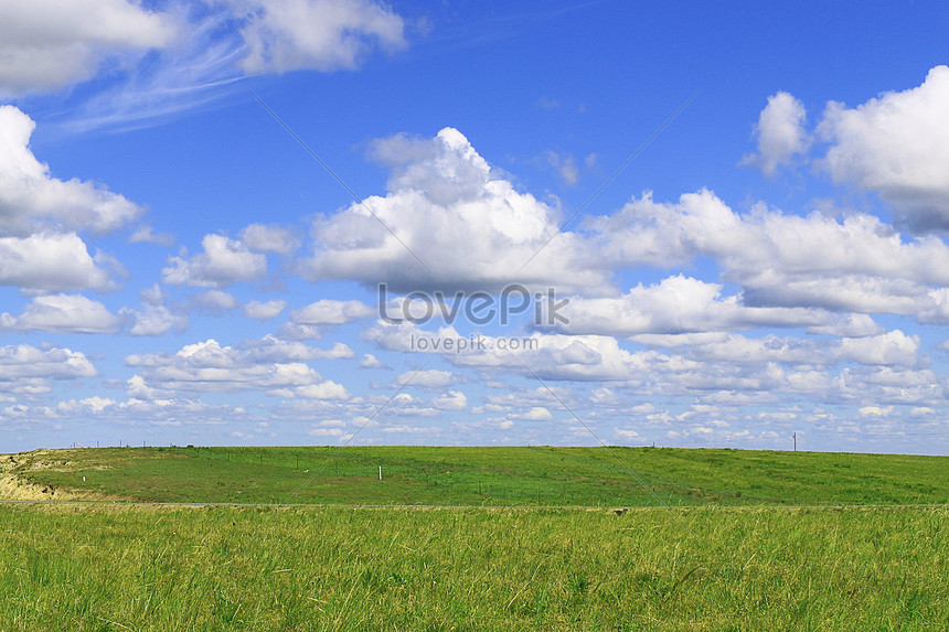 blue sky white clouds and green grass