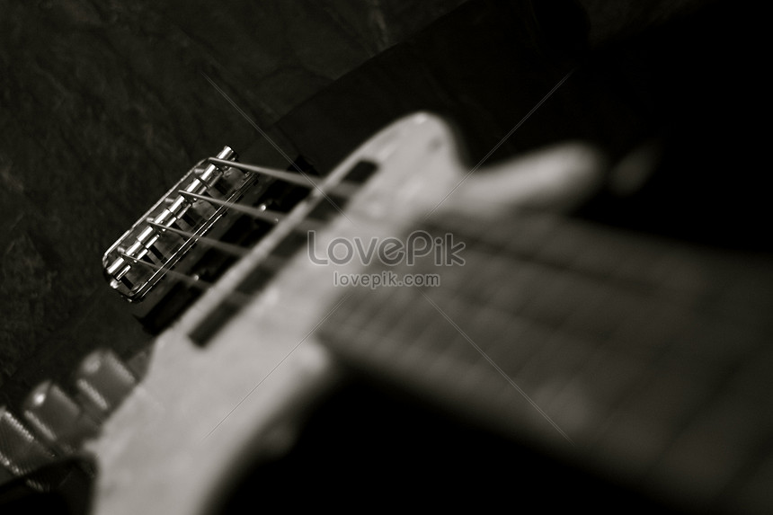 Black and white bass guitar 50 millimeter lens with shallow dep