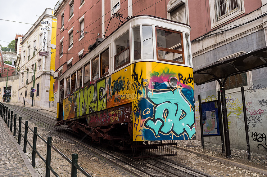 A highrise car with graffiti on the street photo