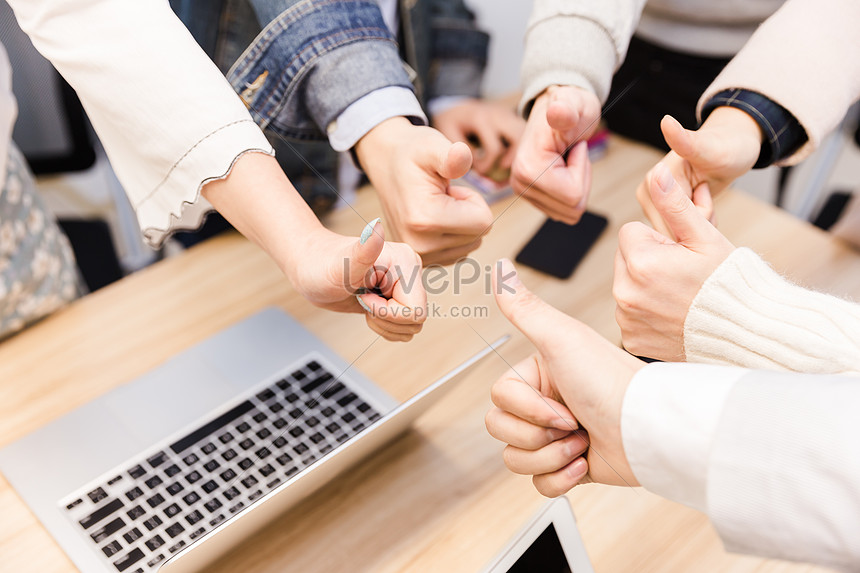 business team with a thumbs up