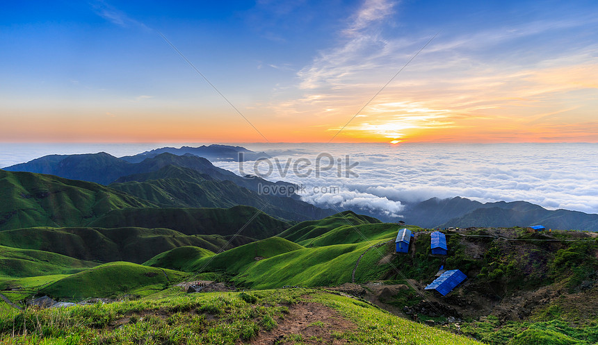 the top of the mountain is sunrise and the beautiful scenery