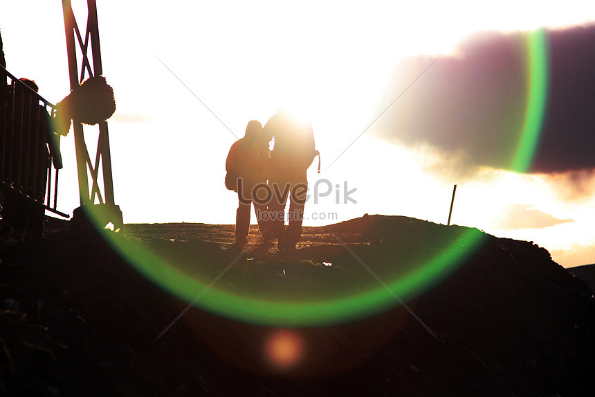 the silhouette of the characters in the setting sun