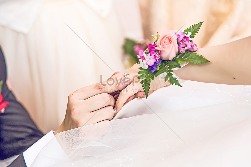 the lover wears a wedding ring with both hands