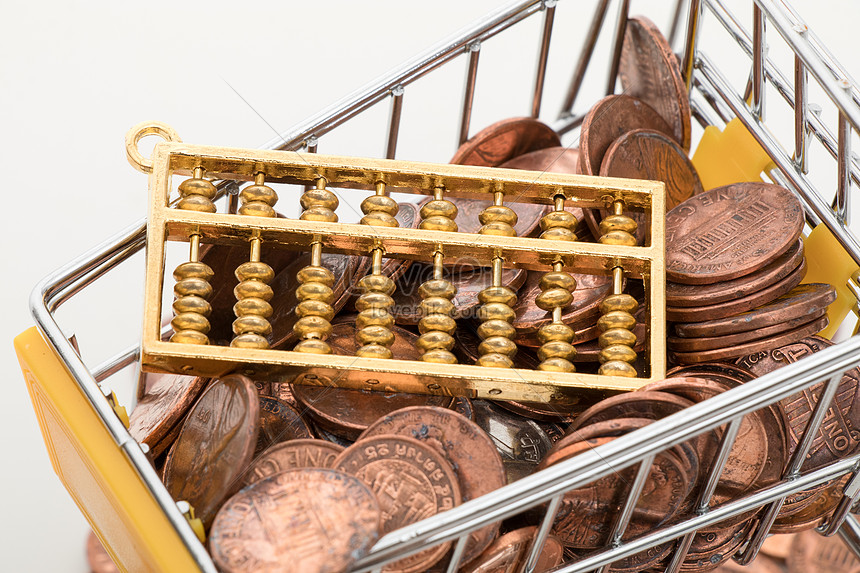 a shopping cart filled with gold coins