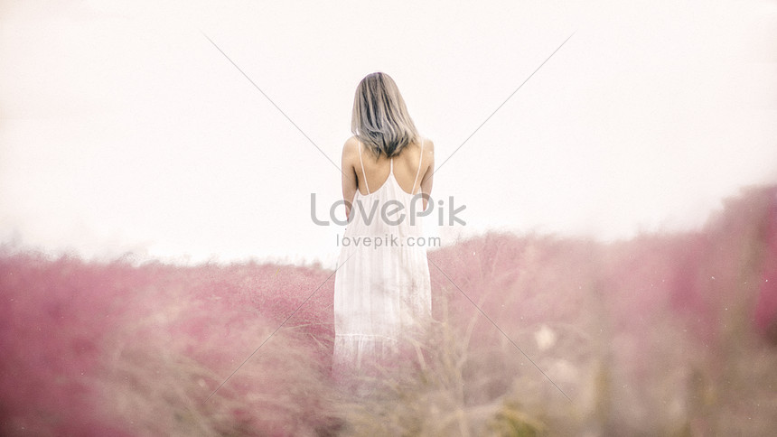the white dress in the flower bushes is only a feminine figure