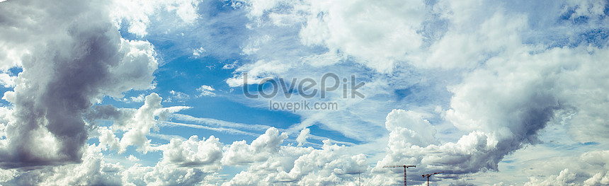 A panoramic view of blue sky and white clouds over the