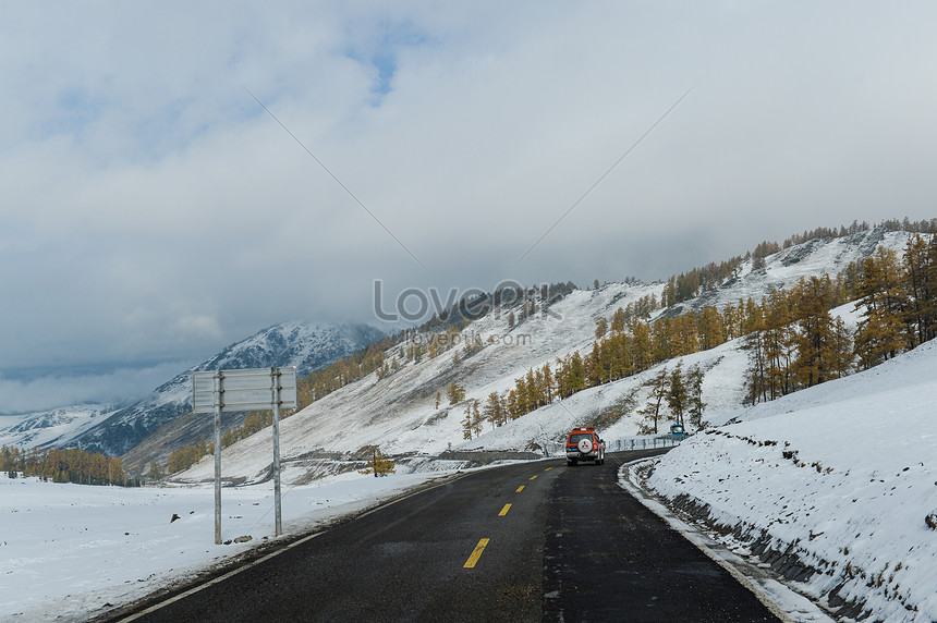the highway under the snow mountain of xinjiang