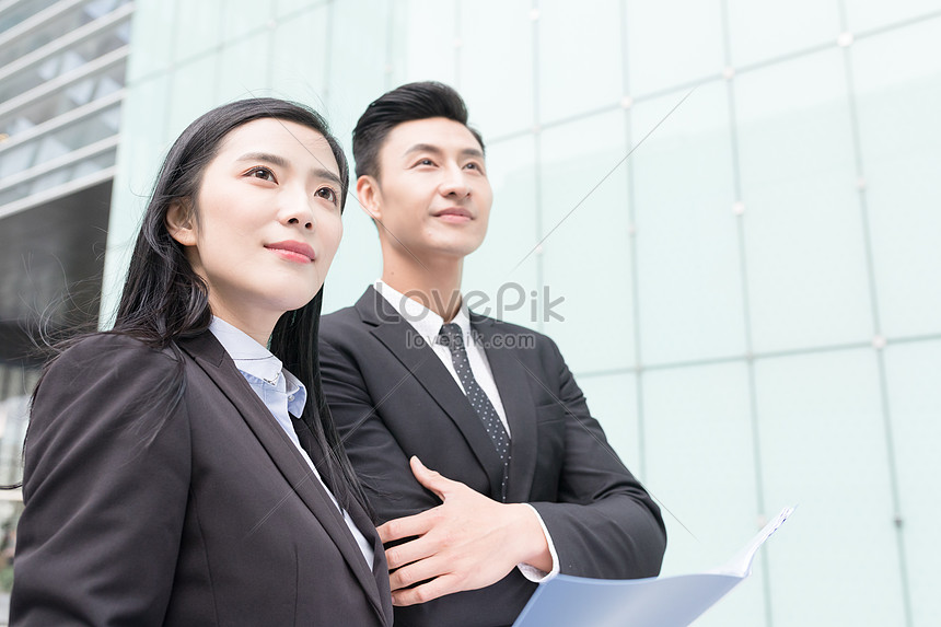 business people who walk and communicate with each other while h