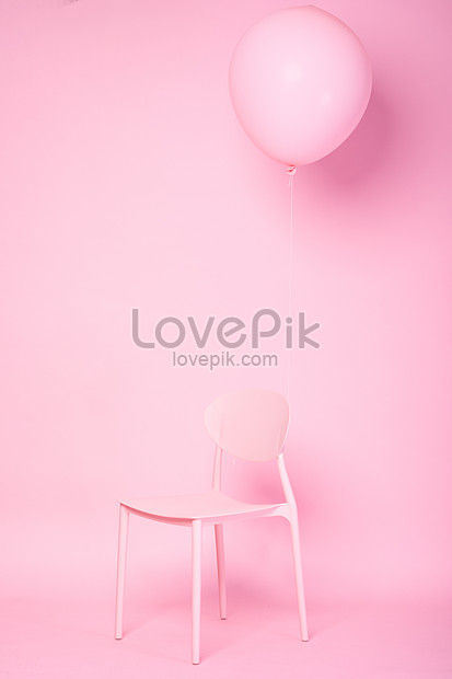 pink chair balloons on the pink background