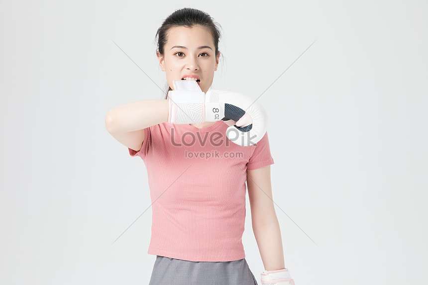 vigorous young female boxing gloves