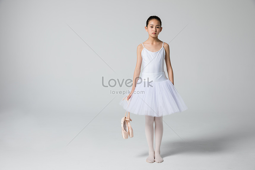 Little girl kneeling dance shoes photo