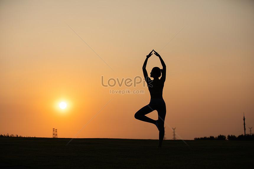 yoga female sunset silhouette