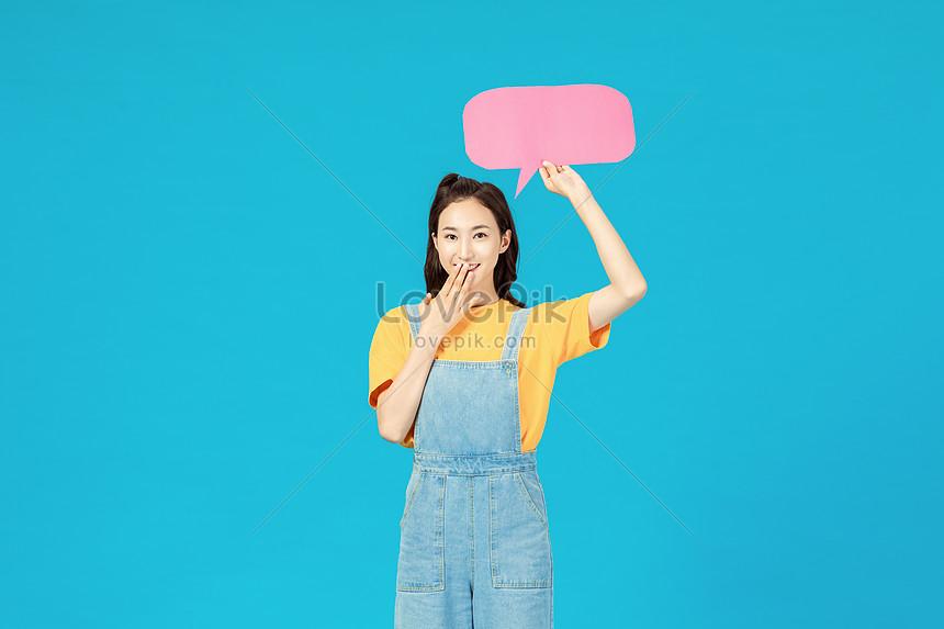 vibrant fashion girl holding a dialog box