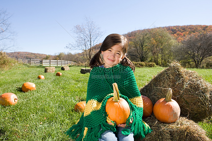 girl in the pumpkin field