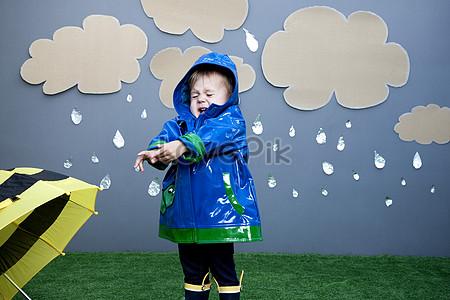 Baby girl with raincoat jpg
