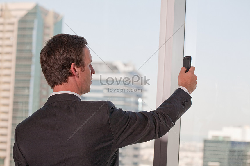 business people holding mobile phones