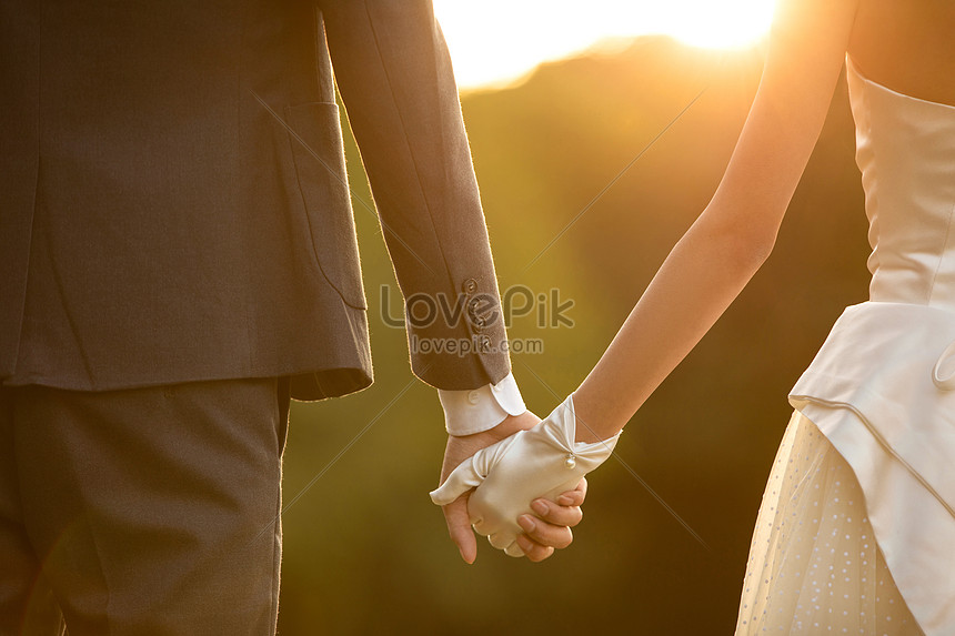 romantic wedding photo close up in the sunset