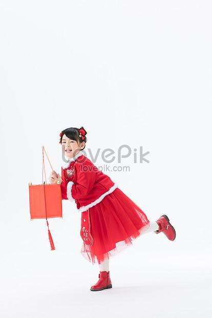 festive little girl holding a lantern