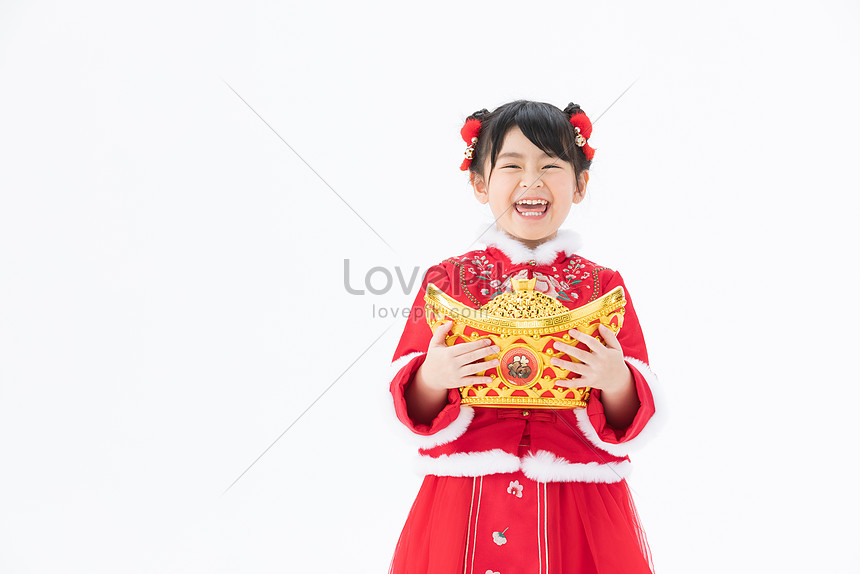little girl holding ingots in her arms and laughing