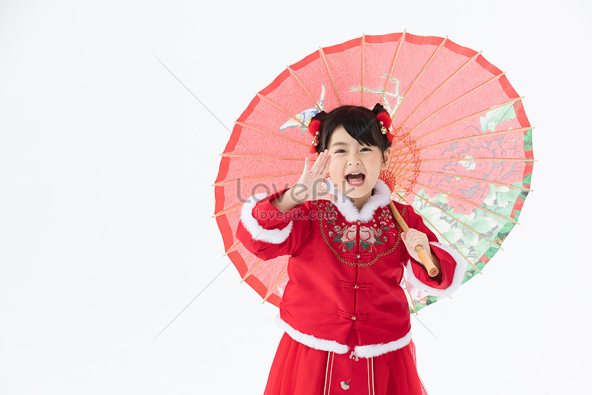 little girl in period costume holding red umbrella shouting