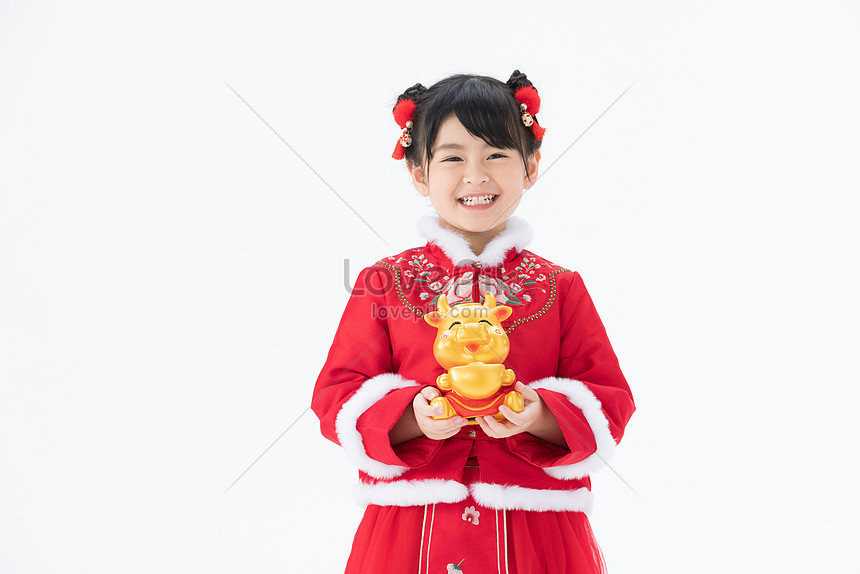 the girl holding the golden bull smiles happily